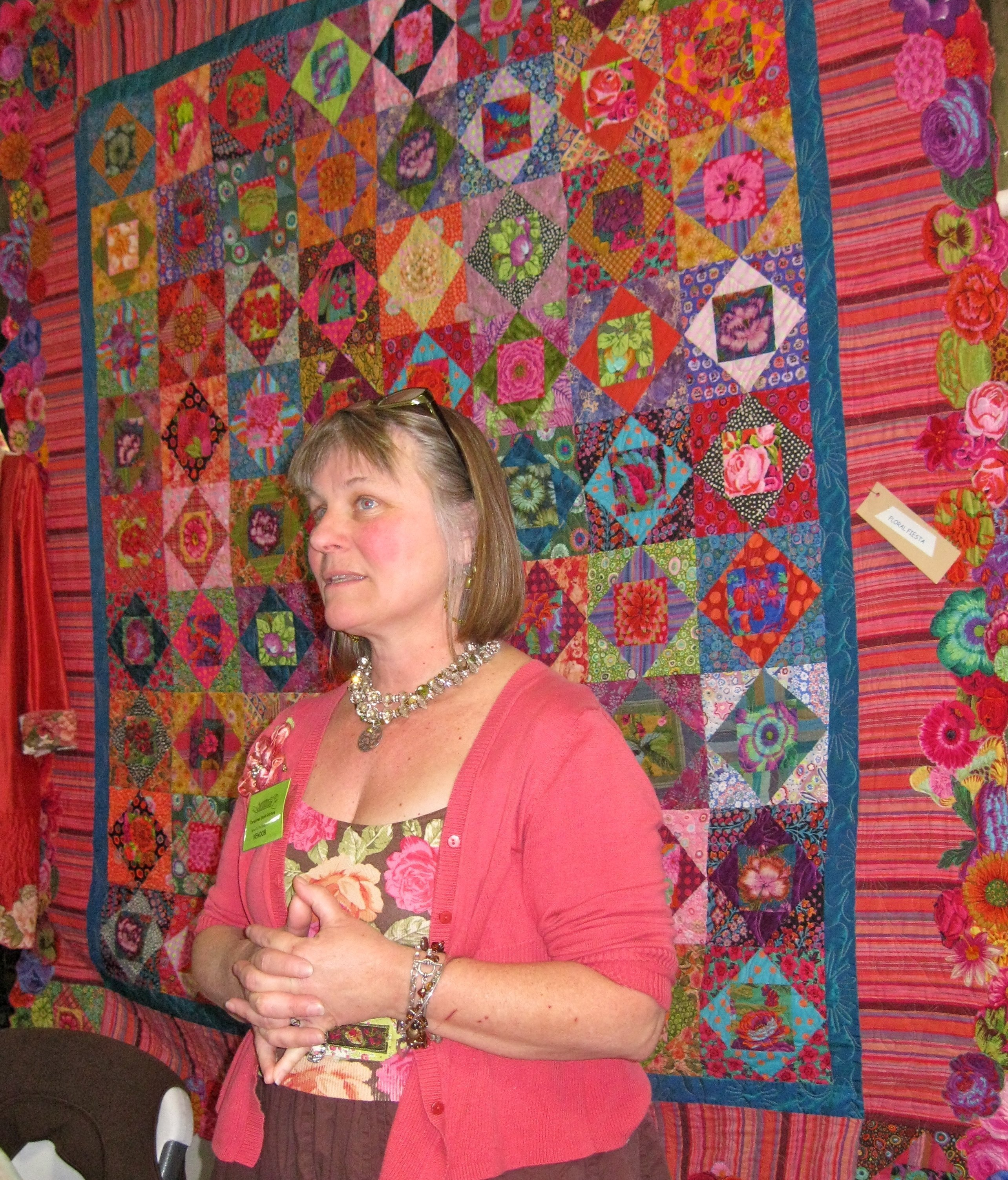 "Janis in front of ""Floral Fiesta"""