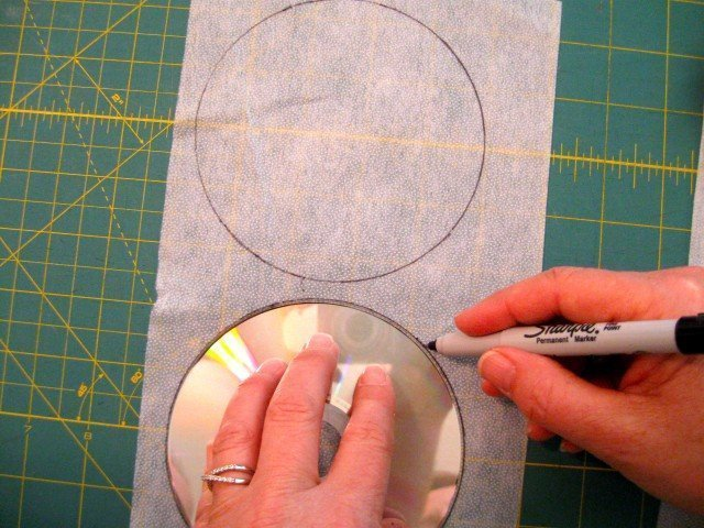 Trace a CD to the bumpy side of the pellon interfacing