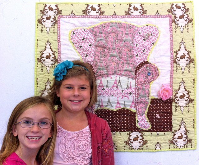 Summit and Eva proudly show off the quilt!