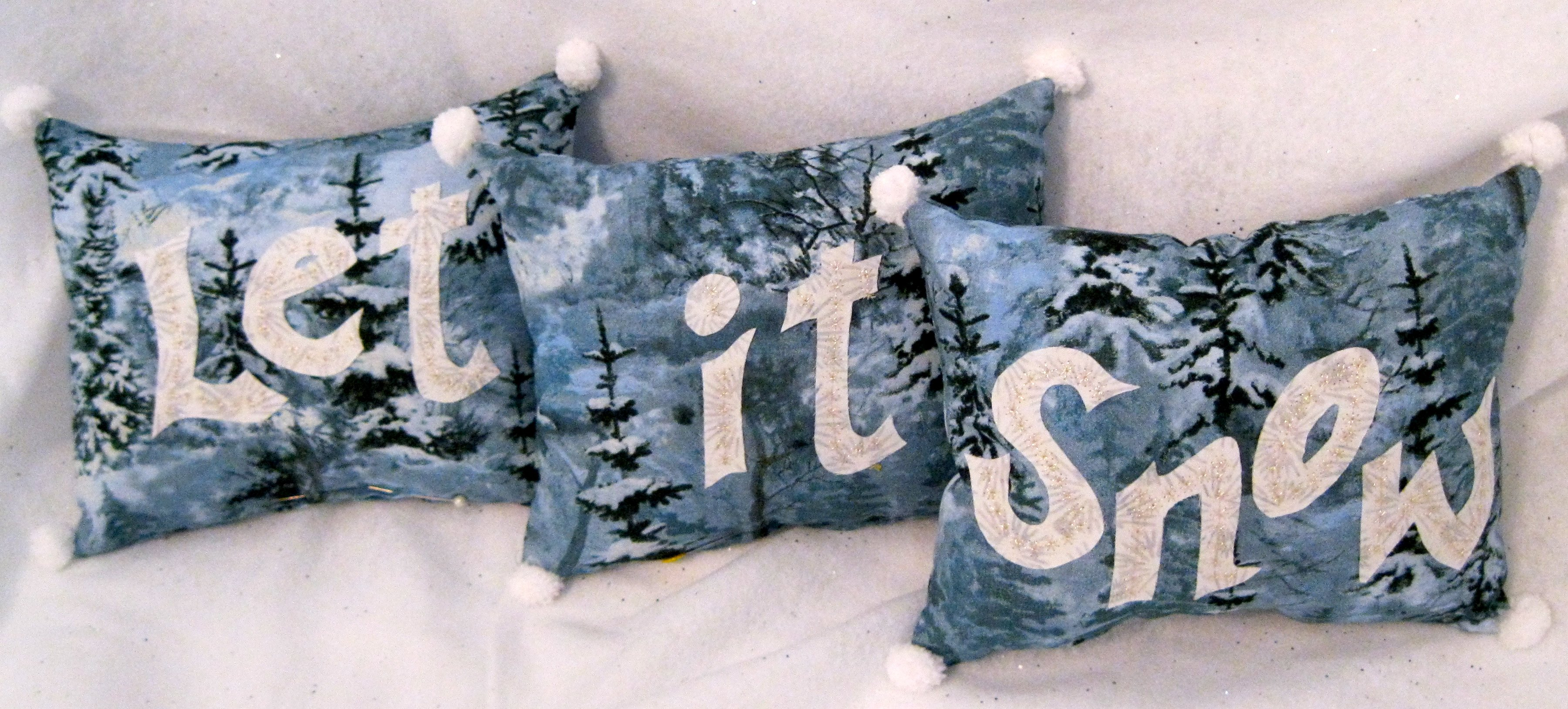 Let It Snow pillows with lovely silver stitching!