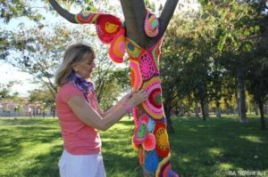 Yarn Bomber in action - she looks a wee bit sinister?