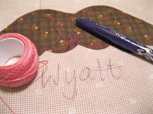 Trace the name and embroider
