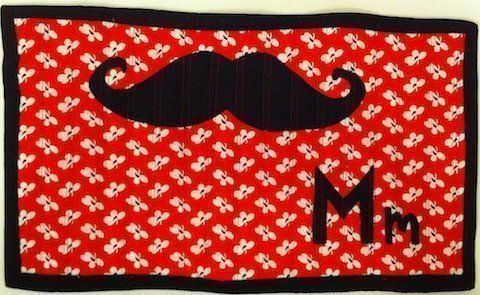 M is for Mustache wall-hanging, by Ashley; 2011