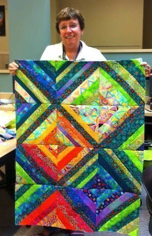 Susan and her amazing quilt top!