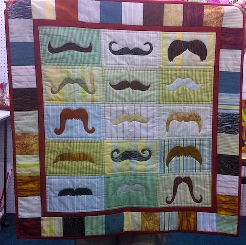 Awesome Mustache quilt made at 50%